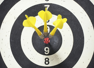 Close-up photo of arrows in a bullseye.