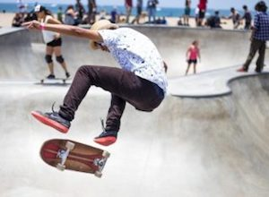 Young male teen skateboarding