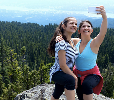 Two women taking selfie with overlook view