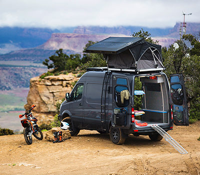 sprinter van and motorcycle with view
